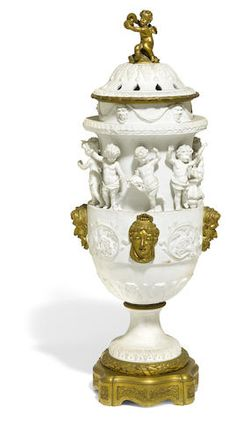 A Sevres style bisque porcelain gilt bronze mounted covered urn late 19th century