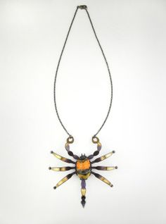 Scorpion Necklace by Incredible Creatures by Mario Salvucci    Scorpion (Pandinus imperator) – In Egypt the Scorpion was worshipped under the guise of the benevolent goddess Selket, protectress of the depths of the Earth, who gave her followers miraculous healing powers.    Center Piece: 8.2 x 8.5 x 2 cm / 3.2 x 3.4 x 0.8 in  Stone: 27 x 17 x 12 mm / 1.1 ...