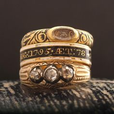 This spectacular and rare mourning ring was made in the first years of what is now known as the Georgian era. The head of the ring features a flat cut rock crystal with an oval collet. The crystal houses a well-preserved white enamel skull and crossbones flanked by the cipher of the deceased,