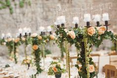 OK, THIS is the last one.  The best part is that this could be adapted to ANY style/color. Just use more rustic candelabra... with any color flowers you like.