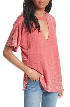 Drop-shoulder styling and a front keyhole cutout intensify the casual-cool attitude of this triblend burnout tee.