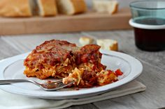 Lasagna Bolognese a rich and flavorful recipe that combines layers of cheese and noodles with a homemade ragu of beef, sausage and pancetta.