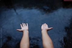 Stock photo of Child extending her hands out in the rain,top view by saptakganguly Blue Rain, Top View, Stock Photos