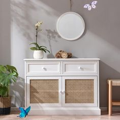 Homerton Solid Wood and Rattan 2 Door 2 Drawer Sideboard Homerton Solid Wood and Rattan 2 Door 2 Drawer Sideboard<br> Our Homerton sideboard is beautifully made with solid poplar wood in smooth white painted finish and natural rattan weaves.. The sideboard offers plenty of storage space, with two top drawers and a large cupboard that includes a shelf which can be filled with clothes, shoes, books, and more.. Due to the natural material used, small fibres may appear on the cupboard door… Small Cupboard, Cupboard Doors, Solid Wood Cabinets, White Cabinets, Modern Kitchen Lighting, White Tv, Best Kitchen Cabinets, Timber Deck, Display Homes