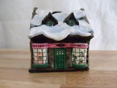 Honeydukes Store - made from $1 store ceramic house, clay, and paint.  (Could alter this to make window displays using movie images)