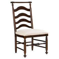 Add country manor style to your dining room or office with this wood side chair, showcasing a curved ladder back, upholstered seat, and turned details.