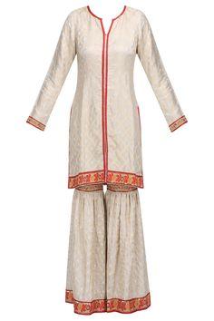 Ivory and gold banarasi silk straight kurta and garara pants set available only at Pernia's Pop Up Shop.