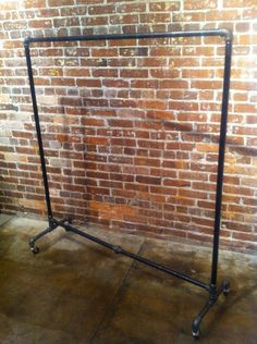 Vintage Rolling Clothing Rack -Made in the USA from Black Pipe and Fittings -Easily assembled and disassembled Options: 4 swivel wheels Rolling Clothes Rack, Pipe Clothes Rack, Rolling Rack, Pipe Furniture, Apartment Furniture, Urban Furniture, Apartment Ideas, Retail Clothing Racks, Pipe Rack