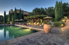 Another view of the pool that shows off the property's Italian influences.