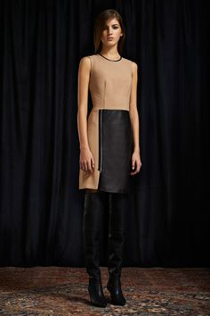 Love this nude colored dress, the black adds a kick of elegance