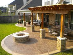 Patio Cover and cedar pergola with stamped concrete and fire pit Missouri City…