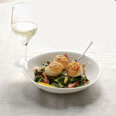Seared Scallops with Bacon-Braised Chard - To help brown the scallops, add butter to the pan halfway through cooking. The butter and bacon that flavor the colorful chard make the dish nicely rich. http://www.foodandwine.com/recipes/seared-scallops-bacon-braised-chard