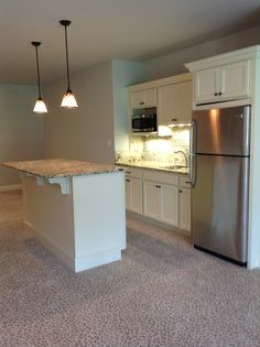 Basement kitchenette -- no stove but plenty of space for portable induction or toaster oven etc. too much to ask for DW?