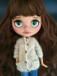 Casual knitted cardigan with pockets and buttons for Blythe or similar Dolls. Hand knitted in fine soft Mohair Cardigan Sweater with button holes and pockets. Available in beige. If you would like this dress in different color just contact me to discuss. Cardigan is seamless and