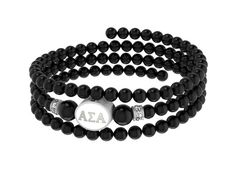 Black Onyx, Sterling Silver Enamel Beads, and Swarovski Crystals are combined to create our Alpha Sigma Alpha three strand memory wire bracelet. The Sorority bead is cast in solid sterling silver and hand finished to achieve maximum detail. The beads are polished black onyx with a bright semi-gloss surface and the crystal roundels are genuine Swarovski Crystal. Designed by sorority sisters for a fresh clean look. Proudly Made in the USA. $89.