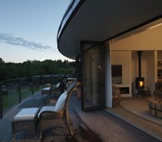The Treehouses at Chewton Glen, in Hampshire, England, bring modern architecture to a wooded setting. Each tree house sits on stilts, above the valley but below the ceiling of trees, providing panoramic forest views. Spend your time relaxing in a Jucuzzi, enjoying the view from your private deck, or snuggling up next to the fireplace.
