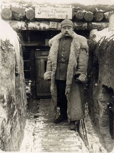 Schiess & Fourier Untffz    German officer outside his digs in a well established trench system.