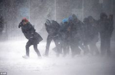 Late-season storm: People struggle to walk in the blowing snow in Boston during a winter storm Tuesday, March 14