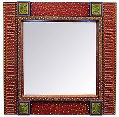 The Karpastado collection of wooden mirrors are intimately and finely painted with designs that offer both vibrancy and depth.  The intricate designs reflect rich Mexican traditions and expert craftsmanship.  This particular mirror has an inset mirror with detailed painted inset border.