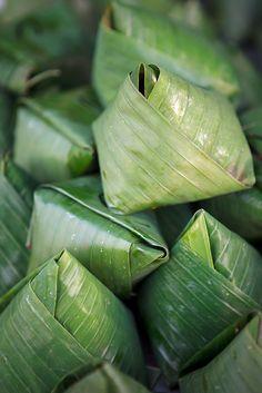 Coconut rice in banana leaf wrap aka nasi lemak