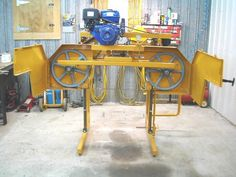 Sawmill by chaikwa -- Homemade sawmill powered by a single-cylinder gasoline engine. Constructed in accordance with commercial plans. http://www.homemadetools.net/homemade-sawmill-2