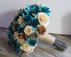 Brown & Teal wedding bouquets. The flowers are made from dyed wood shavings....unique!