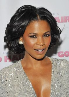NIA LONG - Nia's glowing reddish-brown skin, subtle blue eyeliner, and dusty rose blush compliment her frosted tan lipstick exquisitely. A bit of shimmer on her neck and decolletage highlight the lip color as well.