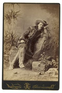 Cabinet Card studio portrait of a young Buffalo Bill Cody wearing his typical buckskin outfit.