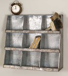 """Enhance your wall space with this unique metal piece. Would do well in a kitchen, or office space. 24½""""W x 8""""D x 23½""""T. Hangs with two keyhole hangers."""