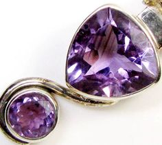 DUAL AMETHYST STYLISH SILVER  PENDANT RT661  TWO AMETHYST GEMSTONE SET IN SILVER PENDANT FROM GEM TRADERS,GEMROCKAUCTIONS