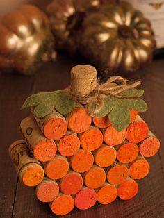 How to Make a Wine Cork Pumpkin: All you need is a little paint, hot glue, felt and a piece of twine to recycle some old wine corks into a cute fall table decoration that will last for years.