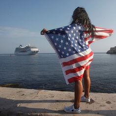A woman with a U.S. flag welcomes the U.S. Carnival cruise ship Adonia in Havana bay Cuba on May 2 2016. The Adonia is the first vessel to sail from Miami Fla. to Cuba in half a century marking a new milestone in the rapprochement between Washington and Havana.  Read more on TIME.com.  Photograph by @reuters. by time