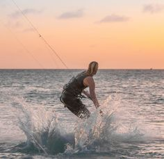 Kitesurfer Splashing down at sunset by Tony Filson - Sports & Fitness Watersports