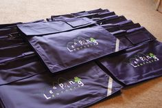Embroidered purple expandable book bags for Leaping learning toddler pre-school group.