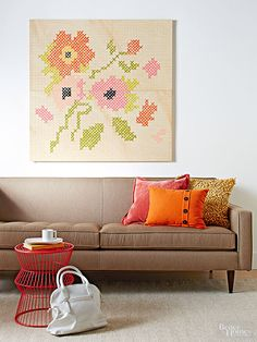 Give an embroidery-inspired look to your accent wall with our easy do-it-yourself design. Instructions: http://www.bhg.com/decorating/do-it-yourself/wall-art/cheap-diy-wall-art/?socsrc=bhgpin092915paintedembroiderywallart&page=9