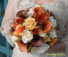 Autumn wedding florals don't have to be fiery reds, yellows, and oranges. This realistic, artificial floral bouquet by Something Floral/Something Spectacular was designed with soft, muted, autumn tones of ivory, peach, burnt orange, soft gold, and brown. The softer color palette projects a warm, romantic, rustic feel.