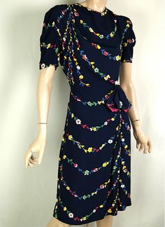 The 40s Rayon day dress -  timeless. I could absolutely wear this today and be perfectly comfortable. Brilliant!