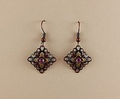 On Sale! Cooper Purple Crystal Earrings $4.99 Copper earrings measure 3/4″L x 3/4″W and are hand painted and embellished with Swarovski crystals.