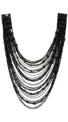 Interesting way to handle so many threads in a necklace, unusual clasp structure.