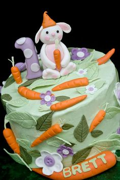 Bunny and carrots first birthday cake