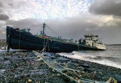 42)  A 168-foot water tanker, the John B. Caddell, sits on the shore Tuesday morning, October 30, 2012 where it ran aground on Front Street in the Stapleton neighborhood of New York's Staten Island. (AP Photo/Sean Sweeney)
