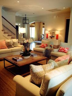 Nice furniture arrangement and like the rustic coffee table with more sophisticated sofas and chairs