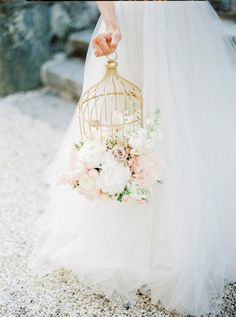 Our venue has a bird cage similar to this that will be placed on a table.  If you have loose flowers, please arrange some in/on this bird cage.