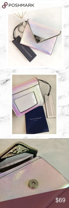 """Rebecca Minkoff Iridescent Wallet Rebecca Minkoff Opal Iridescent Molly Metro Wallet. New With Tags! Size is 5"""" W x 4"""" H and has 3"""" zipper and slip pocket. Magnetic snap closure. Genuine leather. Care card included. Has raw zipper detailing as shown and a beautiful holographic Iridescent color that looks stunning in real life. Like a unicorn! 🦄 Rebecca Minkoff Bags Wallets"""