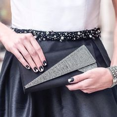 Black and white and bold all over. This holiday season, pair a dress and clutch from @renttherunway with a beautiful essie mani. (Colors used: 'blanc', 'licorice' and a 'matte about you' topcoat.)