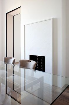 Beautiful black trimmed doorway in the Paris apartment of designer Pierre Yovanovitch