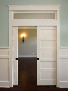 Pocket door for the kitchen and love the framing at the top of the door. I want this over all doorways