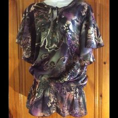 Beautiful silky blouse This blouse has gorgeous flowing arms with a Elastic waist love the purples and grays colors cool print wore it one time very nice stylish blouse great condition  Elan Tops Blouses