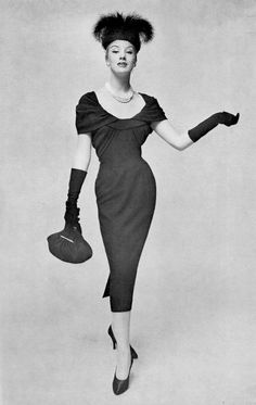 1956 - Barbara Cailleux in Pierre Balmain black wool cocktail dress draped around the shoulders and neckline, black velvet hat adorned with egret feathers and voilette covering the face, photo by Georges Saad, 1956