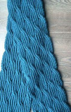 Free Knitting Pattern for Reversible Rivulet Scarf - Purl Soho's reversible scarf features ribbed cables and twisted stitches that look the same on both sides. Pictured project by knotlinz